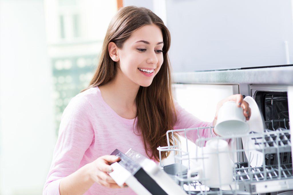 bigstock-Woman-loading-dishwasher-94532900-1024x683