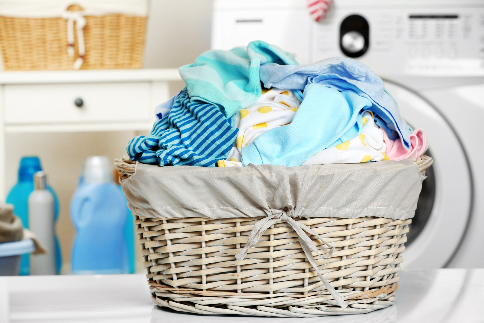 bigstock-Clothes-in-wicker-basket-at-la-168301703