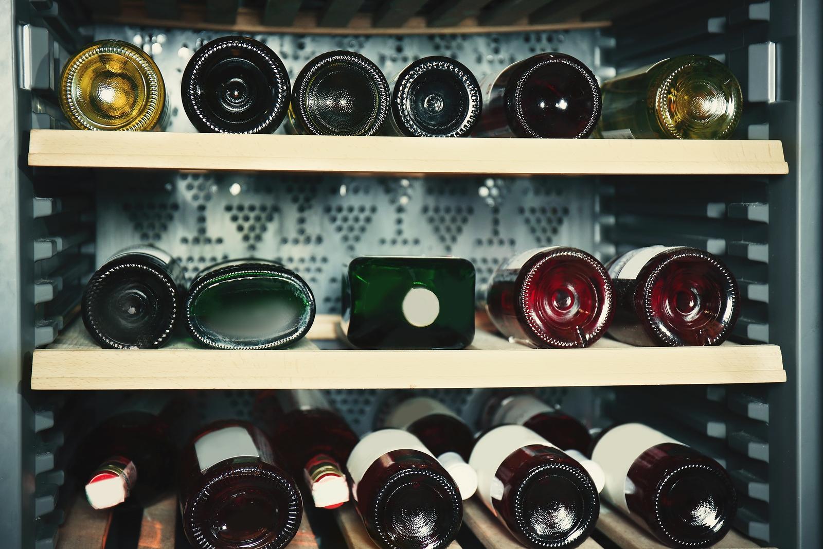 bigstock-Wine-bottles-cooling-in-refrig-180805741