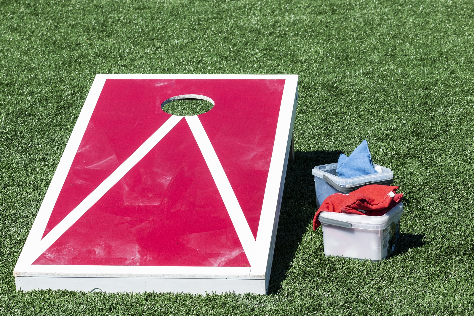 bigstock-Red-Corn-Hole-Game-With-White-308215237
