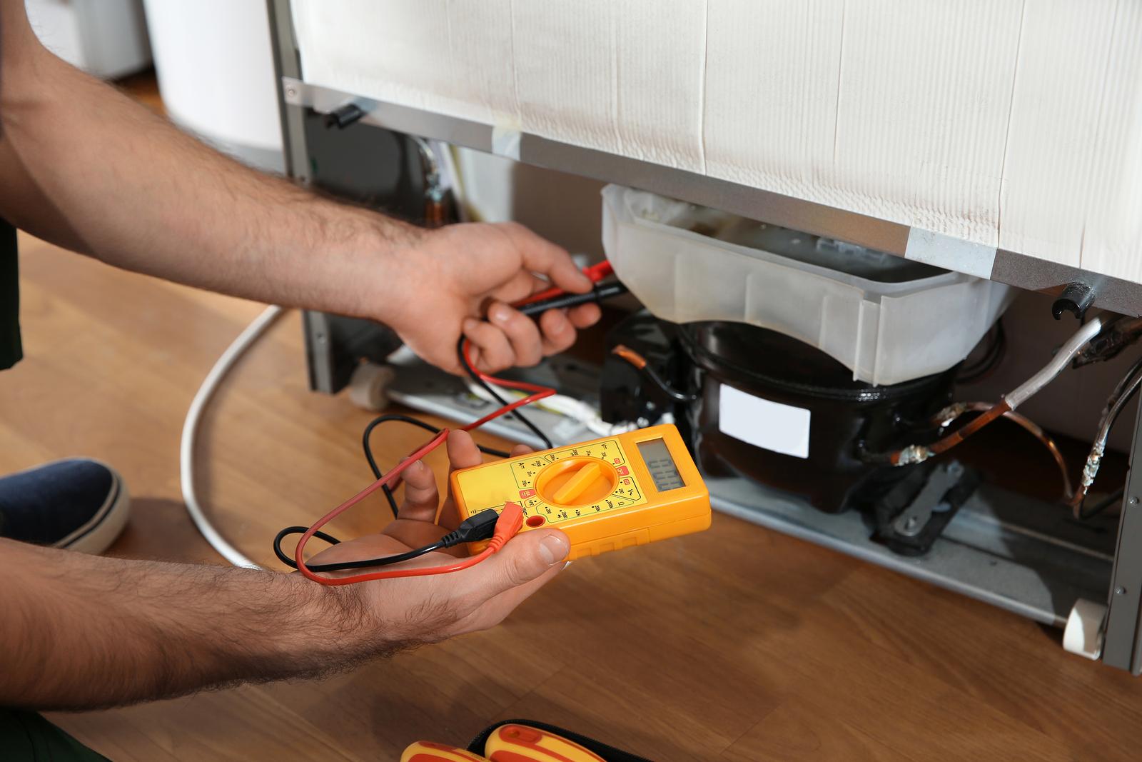 bigstock-Male-Technician-Repairing-Brok-280610956