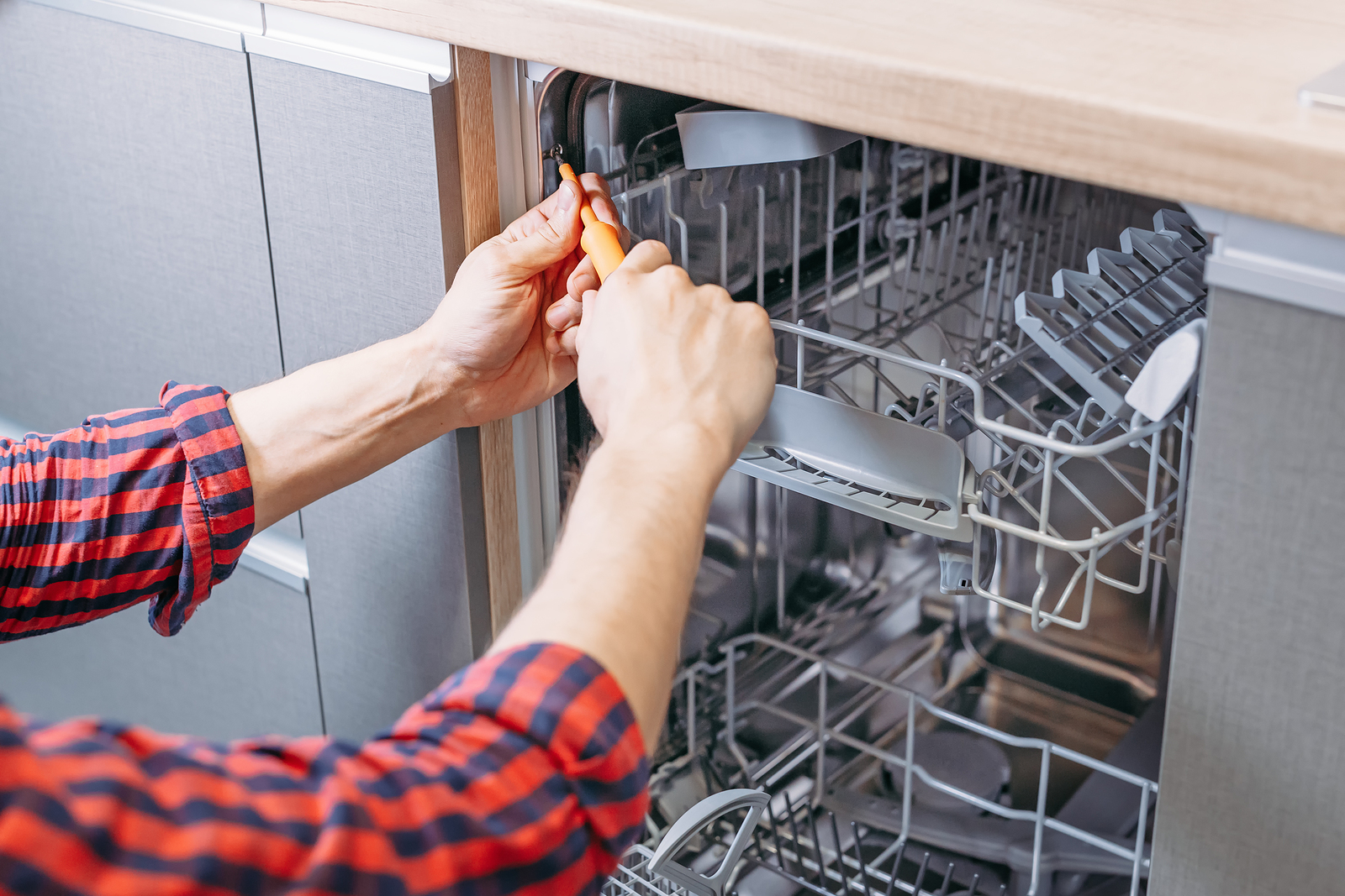 bigstock-Man-Repairing-Dishwasher-Male-257599267