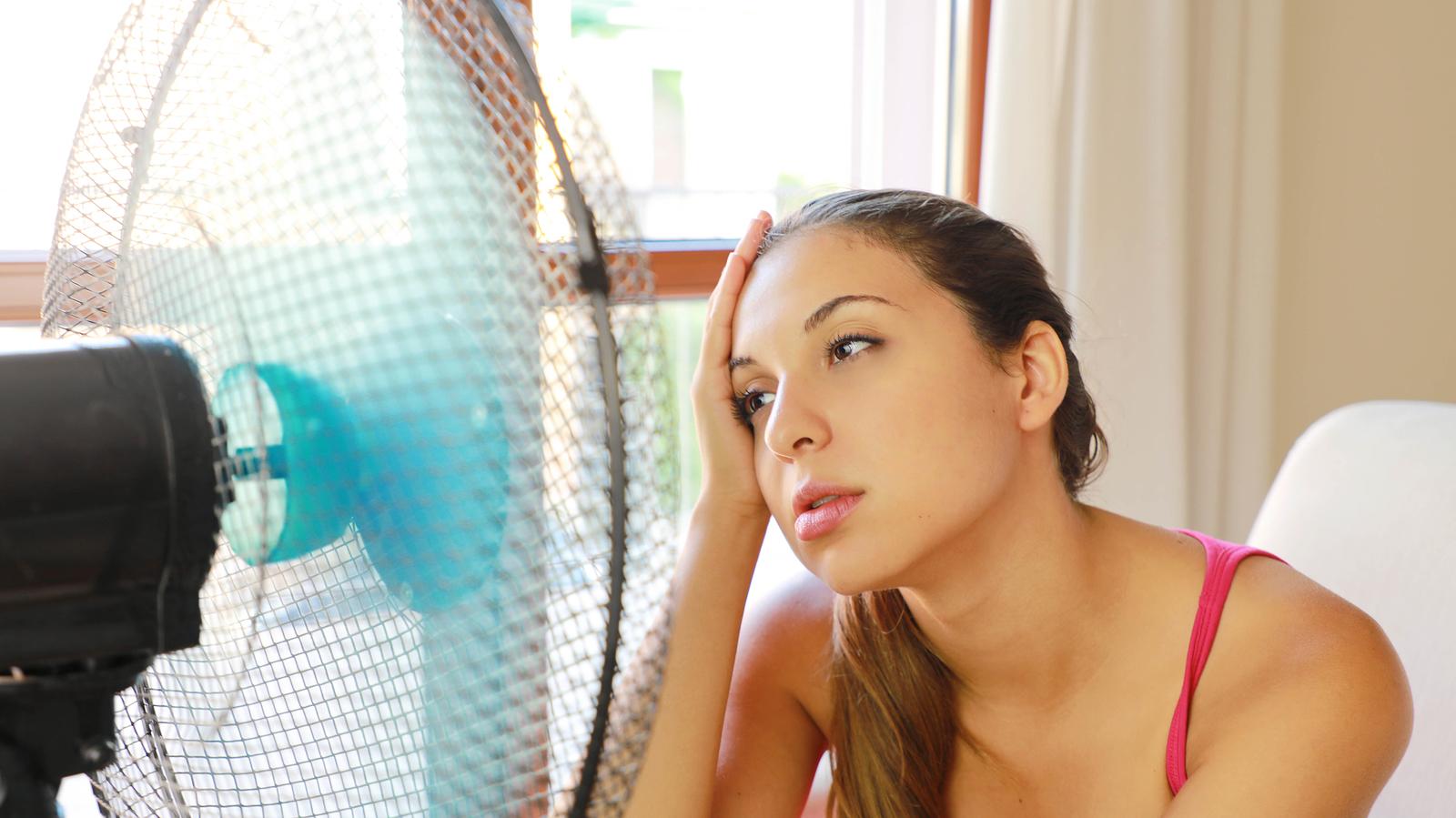 bigstock-Girl-Suffering-A-Heat-Wave-Usi-318588751