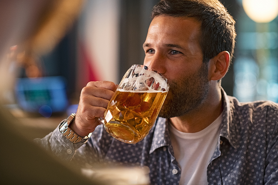 bigstock-handsome-young-man-drinking-a-367156927