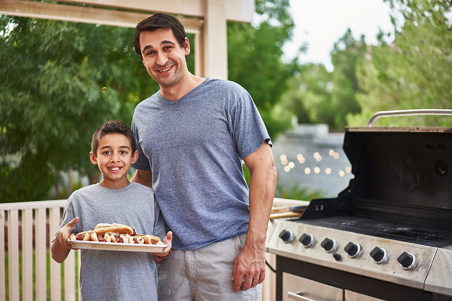 bigstock-proud-father-and-son-showing-t-294471556